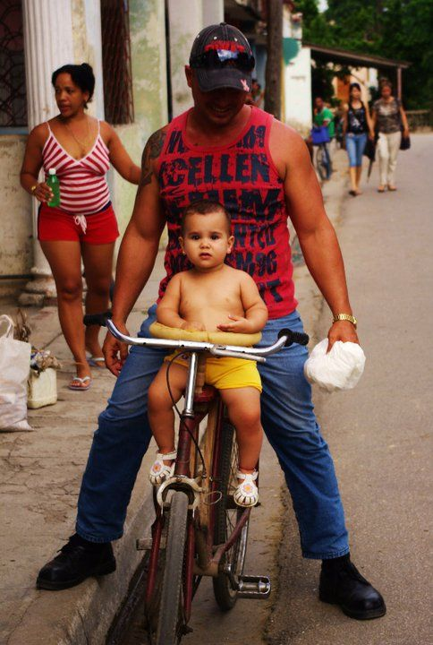 cuban man with baby on bike in Sancti Spiritus