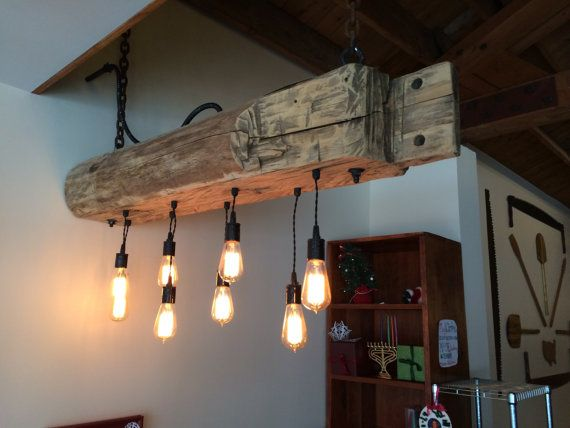 "Add a rustic, industrial feel to your home, restaurant, bar or wherever with a reclaimed barn beam light fixture. Beams are reclaimed from 100+ year old barns from the Midwest. Height and width of most beams are between 7-9"". Not all beams are the same. Some may contain more or less negative spaces, checks, cut marks or other unique features. All measurements approximate. Length of wire and chain can be customized according to your ceiling height. -LED Edison Bulbs (incandescent also…"