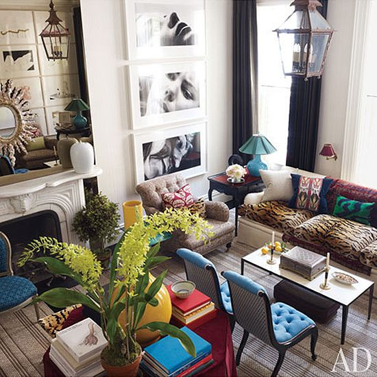 this couch! leopard covered cushions... oriental rug draped through the center...  mixed print pillows!