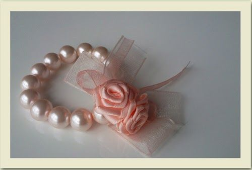 Beads and satin ribbon roses to wear on the wrist. Seeifairytalewedding.blogspot. com for more shots of beaded and ribboned corsages. Keyw...