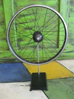 The Wheel Deal. Bicycle wheel sculpture on vintage medical iron base. $125