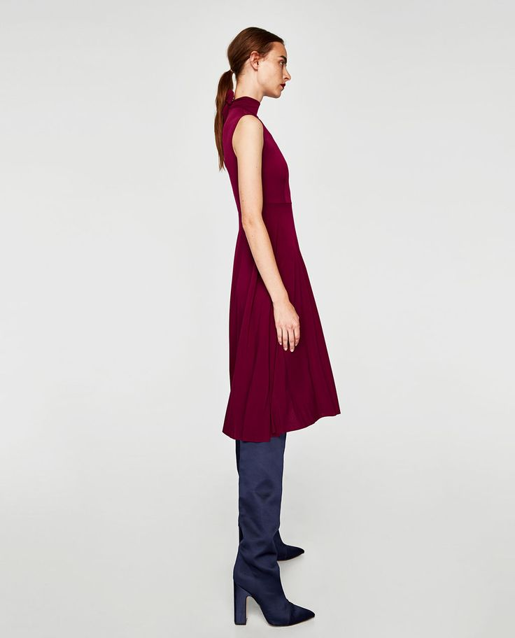 So simple, but burgandy ... with a mock neck ... and over-the-knee boots ... makes for a low-key, must have, 70's influenced staple.