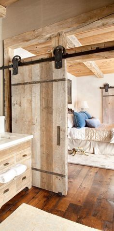 Rustic Bedroom by Peace Designed is awesome for separating bed from Bath