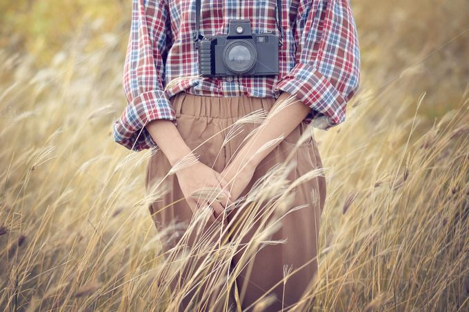 women with vintage camera by bastera on @creativemarket