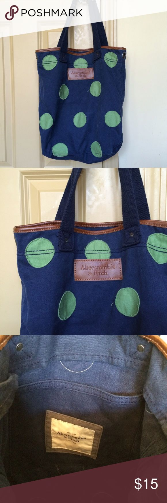 "Abercrombie and Fitch tote bag Abercrombie navy with green polka dot canvas tote. 14""h x 12""w x 5""d with 9"" handle drop. Grommets on each side. One flap pocket on the inside. Great condition. Abercrombie & Fitch Bags Totes"