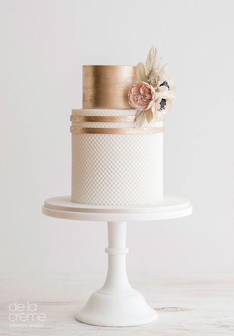 Elegant blush and rose gold wedding cake with flower detail