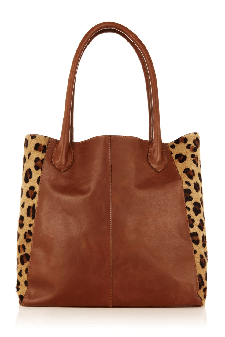 This Oasis leather shopper bag has a gorgeous animal print to the sides and handles to sit over the shoulders.