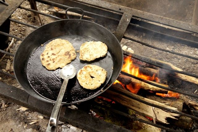 A simple flatbread recipe that's great for camping, you can get the kids to knock it up in no time. Serve with curry or with chocolate spread for pudding!