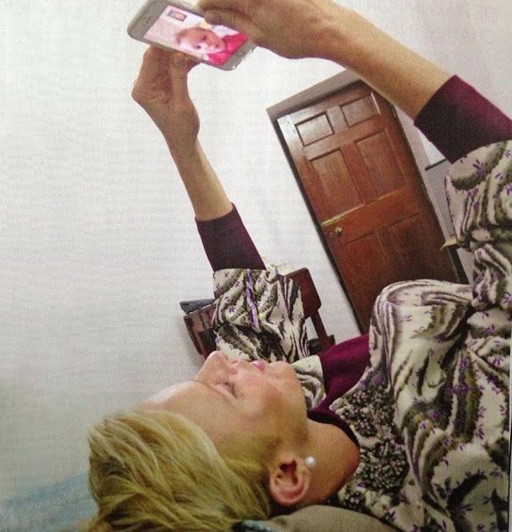 Princess Charlene of Monaco talking with Princess Gabriella via FaceTime on her birthday. This event happened in the Princess Charlene's visit to New Delhi on December, 10, 2016. (Because of the 2016 Child Summit held in New Delhi, Princess Charlene was not with her children's side on their birthday). This photo published on this week's issue of the magazine of Paris Match.