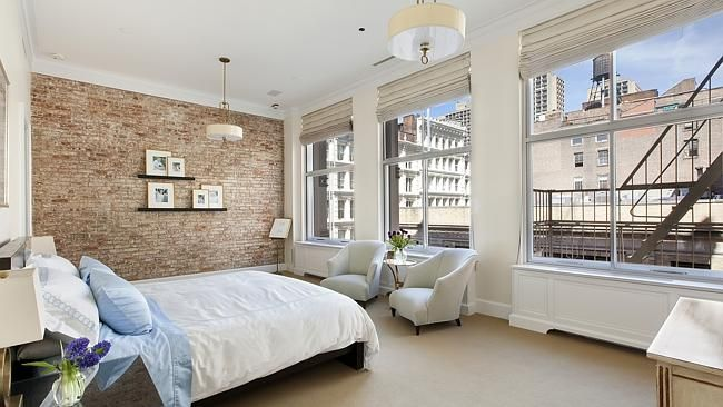 THE Soho apartment where Demi Moore and Patrick Swayze filmed their 1990 movie Ghost has hit the market and you might need a movie star's salary to buy it.  It is listed for $10.5 million US which is equivalent of about $13.7 million in Australia. The 411sq m [4423.9 square feet] apartment on Prince St in Soho has three bedrooms and three and a half bathrooms. The Soho apartment's large windows offer views over the city. Picture: Douglas Elliman