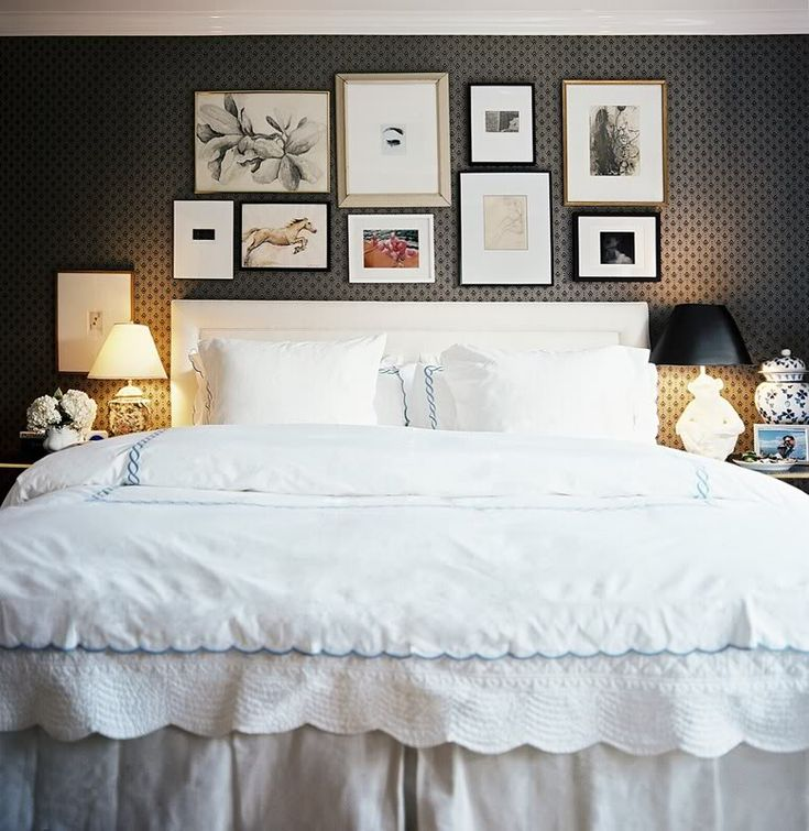 Frames above the bed...lovely room.