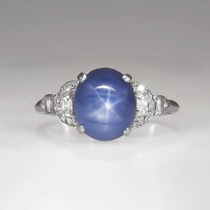 Rare Marcus & Co. 5.76 ct t.w. Lavender Blue Star Sapphire Diamond Ring Platinum by YourJewelryFinder on Etsy https://www.etsy.com/listing/211403572/rare-marcus-co-576-ct-tw-lavender-blue