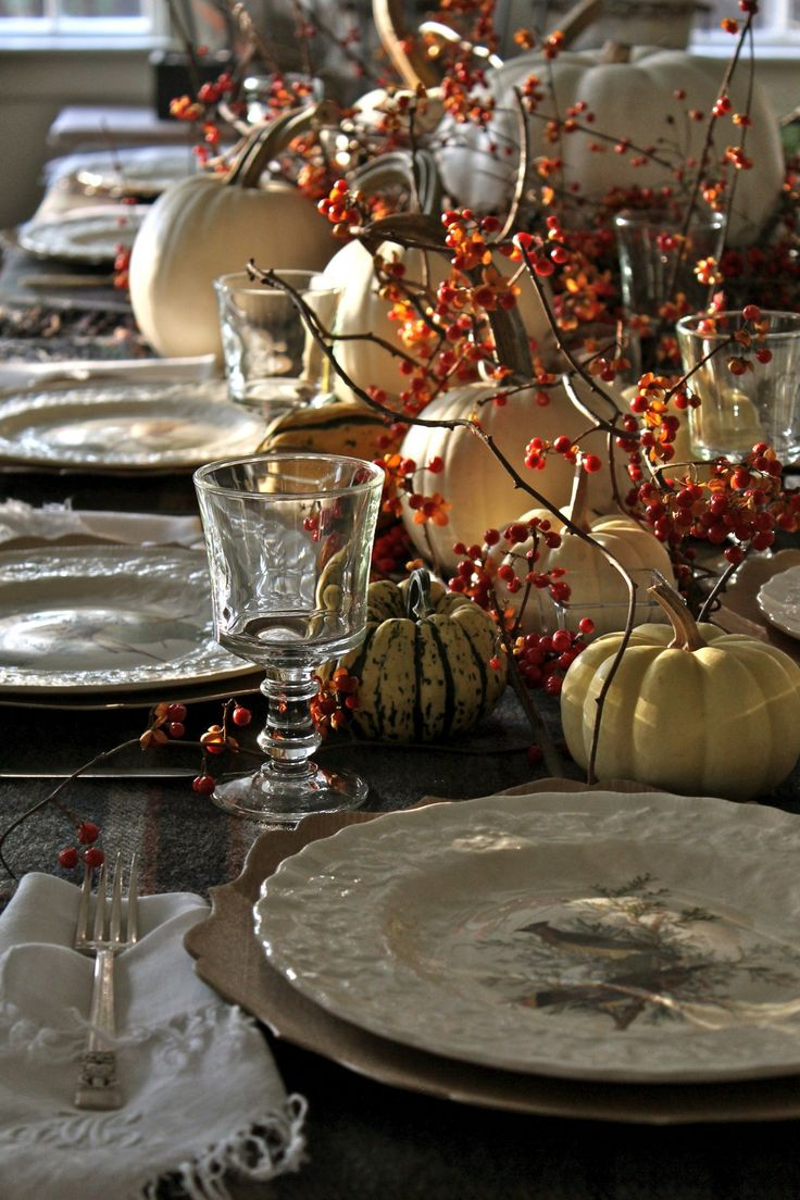 The table's all set, the turkey's in the oven, and it's time to get busy on all the fixin's! I just love this day. Wishing you and yours a wonderfully relaxing (or spirited!) eat, drink, keep reading