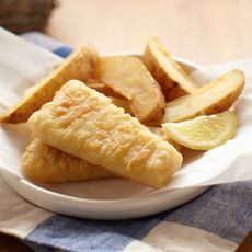 """Jenny's Cuisine: Fish & Chips - Ahoy, mate!  Tender strips of battered pollock and a pile of potato wedges make this meal a perfect """"catch.""""  Don't forget to add the malt vinegar!"""