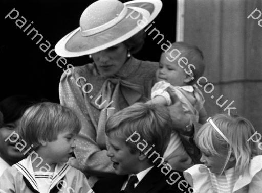 June 15, 1985: Princess Diana holding Prince Harry with (L-R) Prince William, Peter Phillips on the balcony of Buckingham Palace during the Trooping of the Colour ceremony.