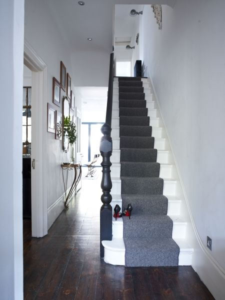 Monochrome chic. Simple is best in a narrow hallway.  White painted stairs make them appear wider and the grey runner is both practical and elegant. Seek out a slim console - vintage or modern - thats useful and decorative but not space-consuming.