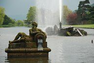 by  Artist Henry Nadauld 1653 1723. The Empress fountain Chatsworth House.   He was a Huguenot sculptor and carver, responsible for sophisticated decorative carving and statues at two of the great English baroque houses. Nadauld was born in France and after the revocation of the Edict of Nantes fled to England.  His son Pierre, born in 1685 in France, was naturalised in 1707 He became a surgeon and raised a family in Ashford, Derbys.