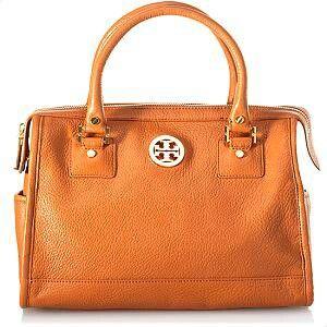 Tan colour with Tory burch handbag. Simly   stunning
