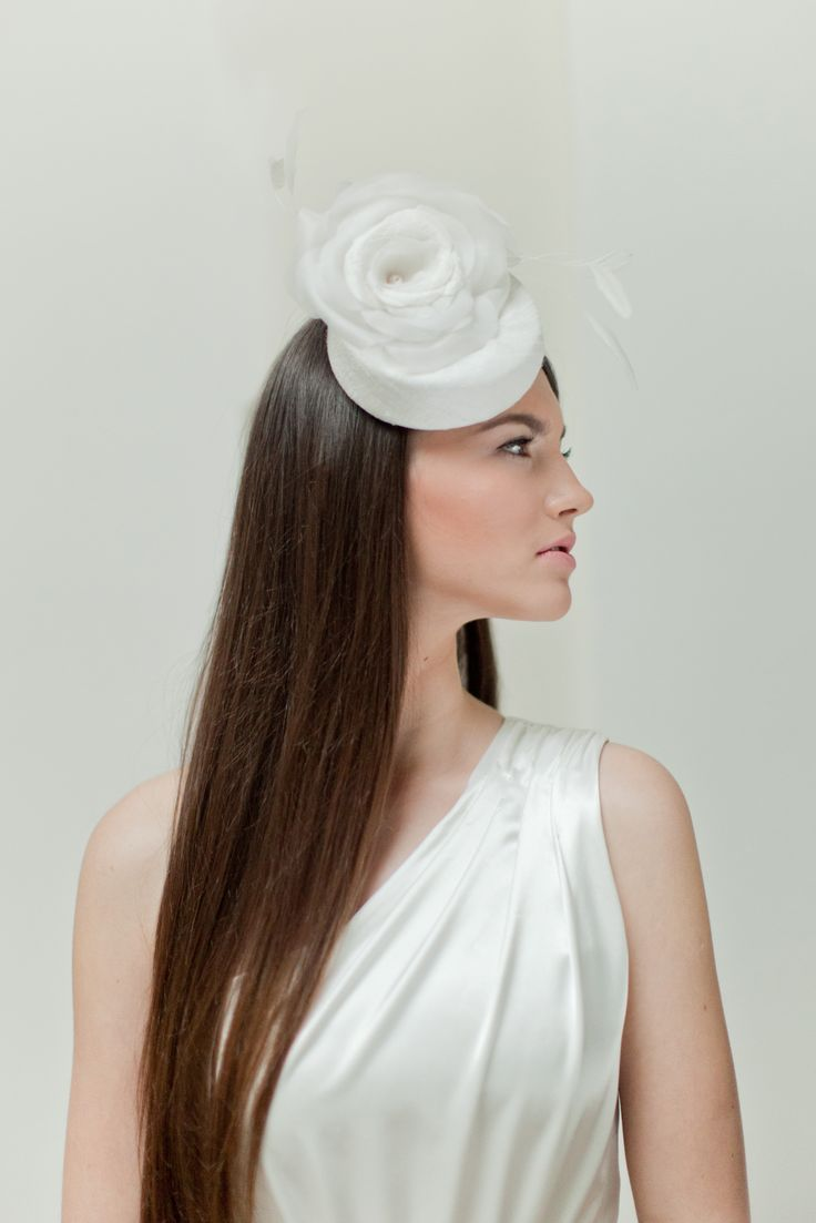 Bridal millinery hat is made of silk blended cotton dupion, silk organza and adorned with feathers. The silk roses are hand made by me using traditional millinery technique - each petal is cut, formed and sewn together with pearl center. I make all my flowers using traditional millinery couture technique and patterns. All my hats are completely hand made. I also create my own hat blocks for moulding cocktail hats.