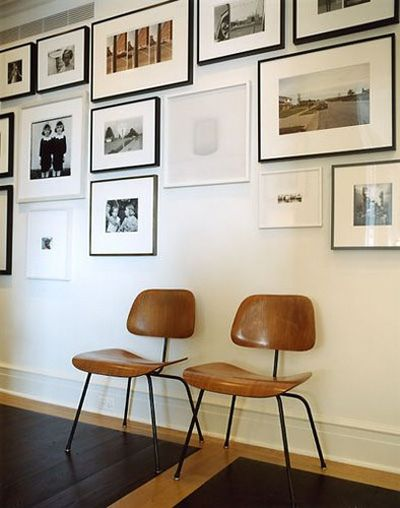 art wall and vintage chairs