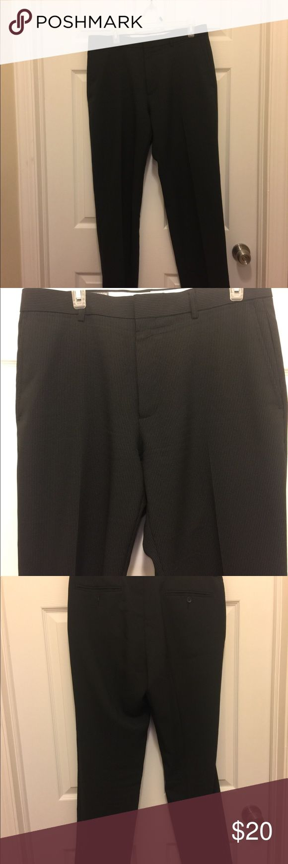 Michael Brandon dress pants Michael Brandon slim fit dress pants. Color is black with white pinstripes. Gently worn; great condition! Only flaw is the button on the back left pocket is missing (can be easily sewed back on with a replacement button). Michael Brandon Pants Dress