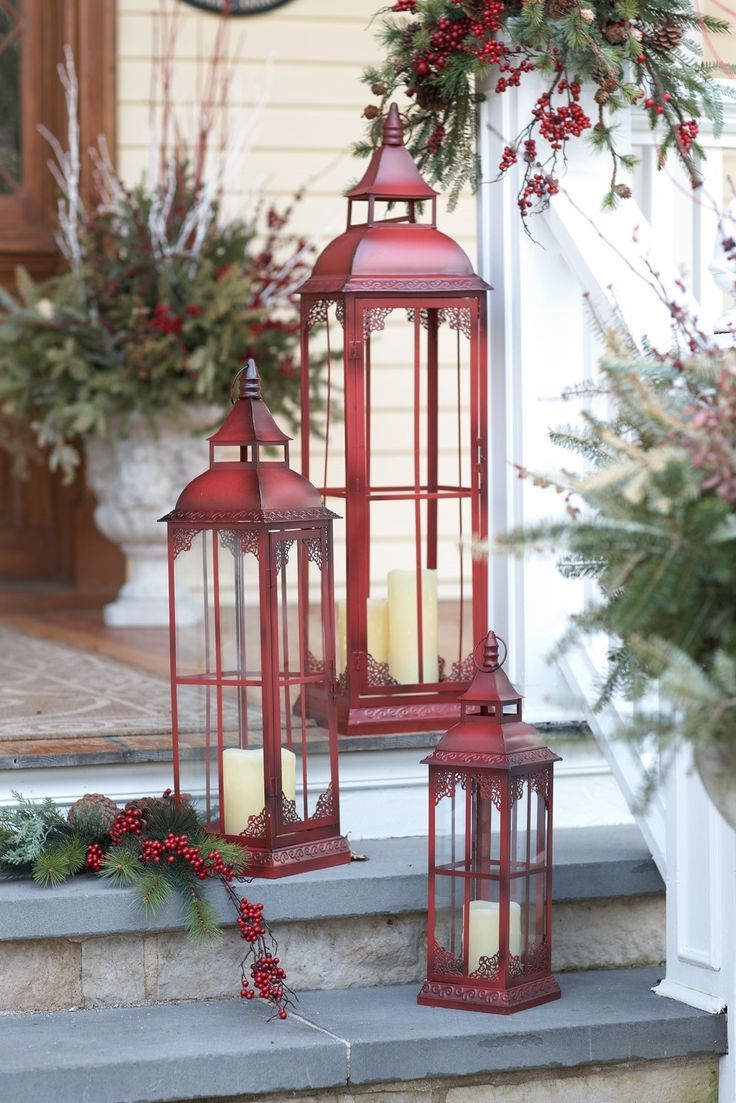 Welcome Home Three Stunning Lanterns In Red Invite Guests With Elegance And Grace A Con Christmas Porch Decor Outdoor Christmas Decorations Green Christmas