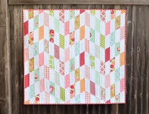 The Striped Chevrons Baby Quilt Tutorial is a super-fast, simple pattern that will let you whip up an easy baby blanket in no time at all.