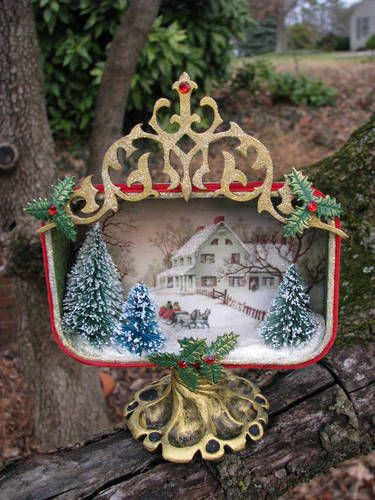 It never ceases to amaze me what people can do with an Altoids tin. All I can do is fill them back up with small, useless items!    A Vintage Christmas Altered Altoid Tin.  The base is made with polyclay.