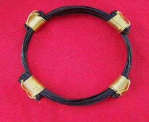 MZ37 4 knot gold elephant hair bracelet  Pure gold wire around the elephant hair knots. Price $240 incl. shipping & ins