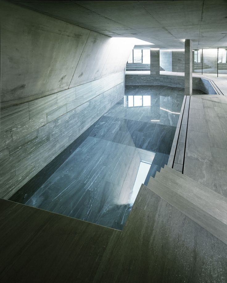 Polished concrete subterranean pool shows off the polygonal floor-plan of this home overlooking Lake Zurich in Switzerland. [2000 2500]
