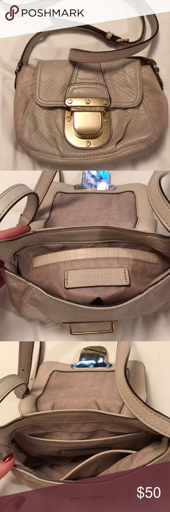 MICHAEL KORS cross body purse Gently used leather crossbody purse! Spacious to fit an iPhone plus size and a few cosmetics for a night out. Long crossbody straps for comfort and security! $50 OBO. Thanks for looking! Michael Kors Bags Crossbody Bags