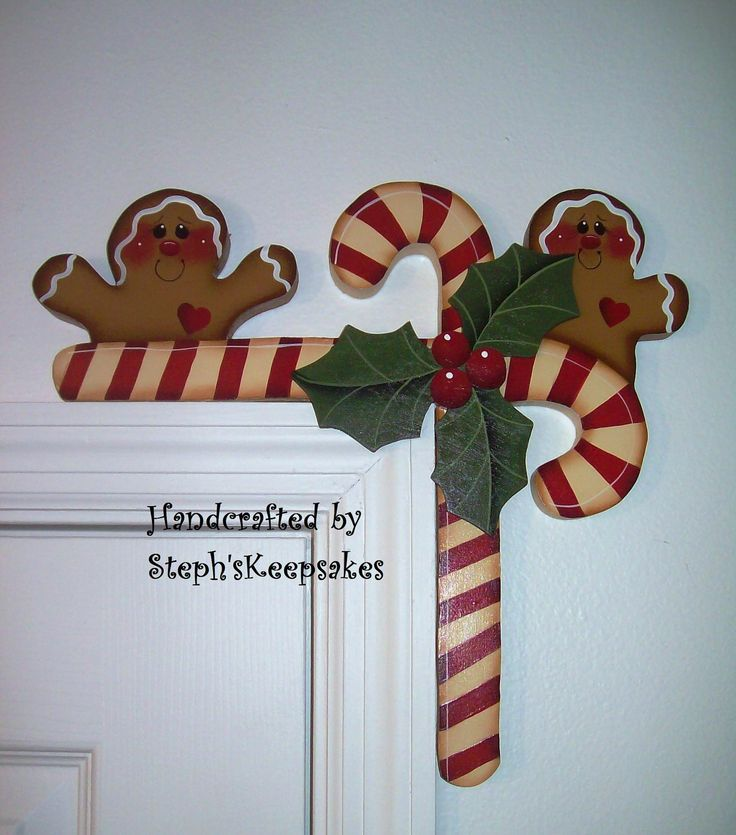 Hand Painted Gingerbread  and Candy Canes Door Huggers. $15.95, via Etsy.