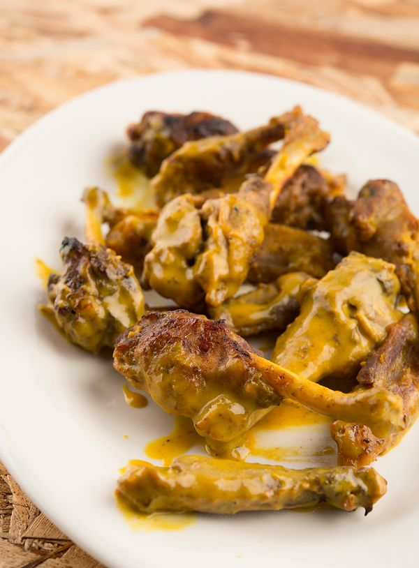 A recipe for duck wings braised until tender, then roasted with a honey-mustard sauce. These are great party appetizers.