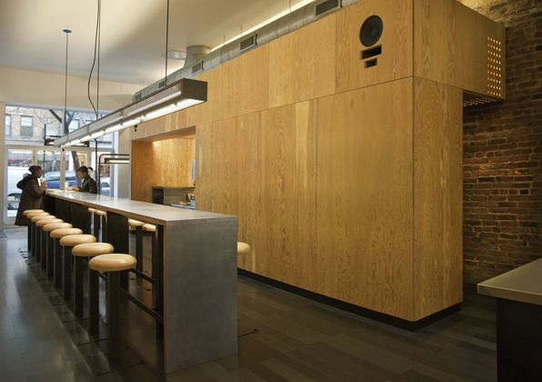 Chipotle Mexican Grill - plywood paneling, linear lighting, stainless table tops