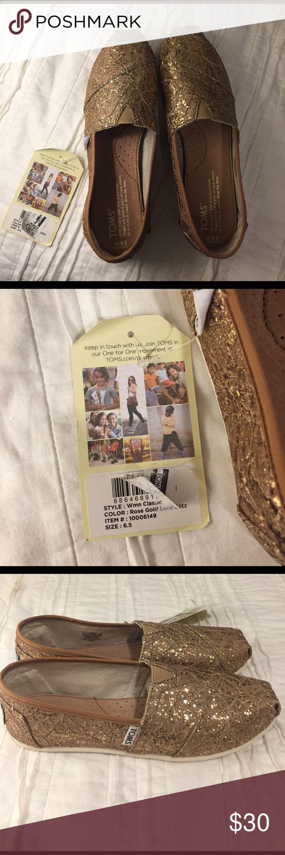6.5 Toms Rose Gold Lace Glitz Beautifully shiny, new with tags Toms shoes in 6.5 Rose Gold Lace Glitz! TOMS Shoes Espadrilles
