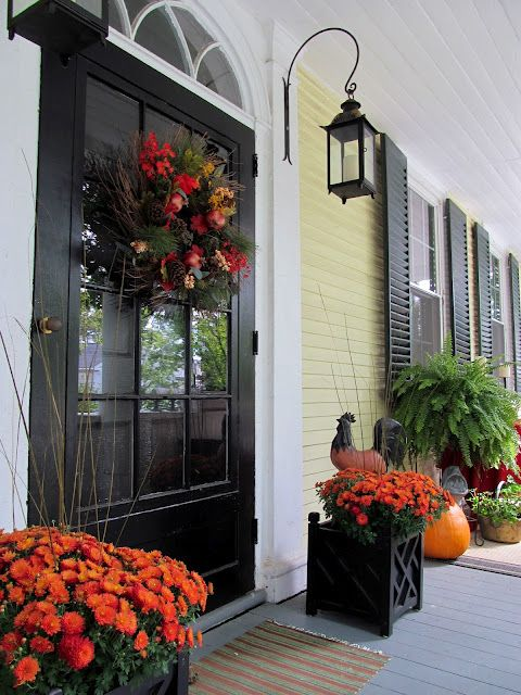 Isn't this a gorgeous porch?  I need to put up my fall wreath.  It's too early for pumpkins and mums in Texas. :)