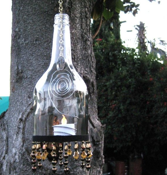 glass bottles hanging from tree | Recycled Brandy Bottle Lantern/Candle Holder by WineDeLights