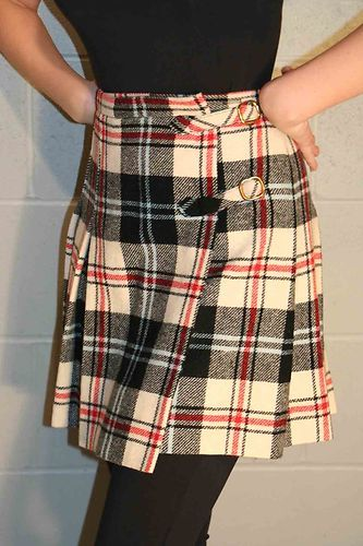 """70's Pleated Skirt by Bobbie Brooks -- I had one with a huge decorative """"safety pin"""" on the flap. LOVED it!"""