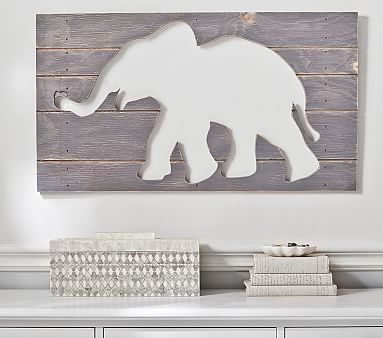 A sweet elephant brings charm to a child's room. The weathered finish on this cut-out plaque adds to its casual appeal.