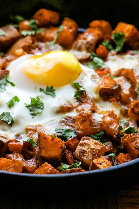 This Mexican sweet potato skillet hash and fried egg topped with melted mozzarella cheese is a hearty vegetarian breakfast or brunch!