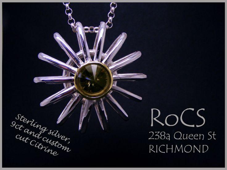 Sunburst pendant with custom cut smokey citrine in 9ct rub setting