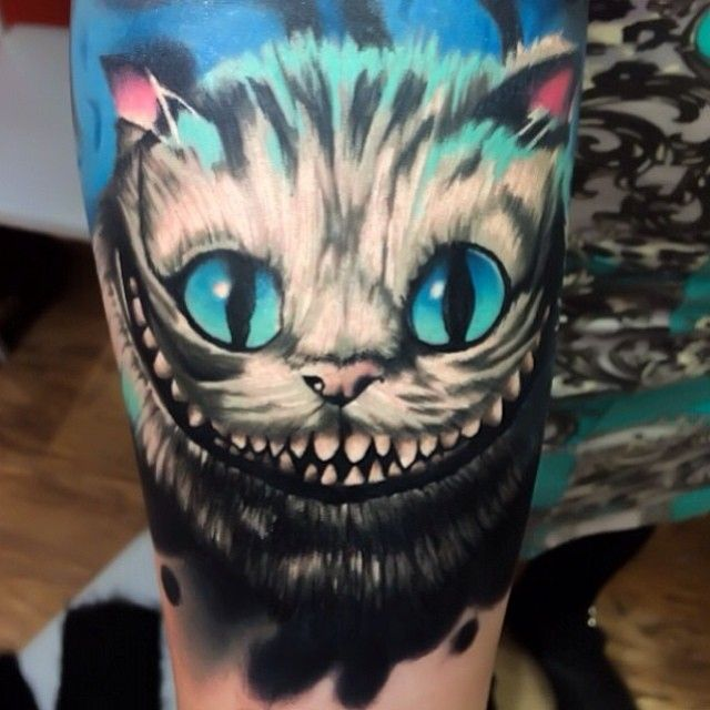 Alice in wonderland cheshire cat tattoo