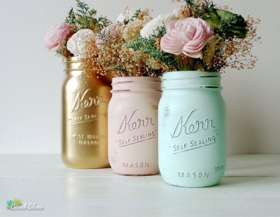Looking for a DIY centerpiece? Mason jars are the definition of rustic chic. Add in a splash of color with some gold, peach, or mint spray paint and watch your floral arrangements come to life // Etsy