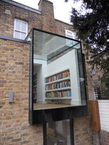 Gorgeous metal and glass extension. The fact that what's visible is a built-in bookcase is the cherry on top of the cake. :)