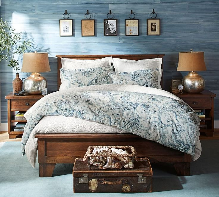 traditional master bedroom with sumatra ii bed frame pottery barn sumatra bedside table faux blue panel wallpaper carpet