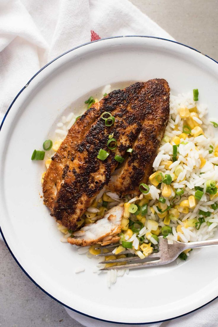 Cajun Blackened Fish | Full of so much flavor, serve this dish with a side of Mahatma White Rice mixed with buttery corn and green onions. Simply delicious!