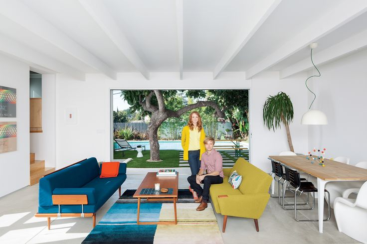Glee star Jayma Mays and actor Adam Campbell in the living room of their Los…