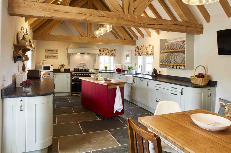 A large kitchen with beautiful oak trusses.  #truss #kitchen #goals #oak #oakframe #welshoakframe #space
