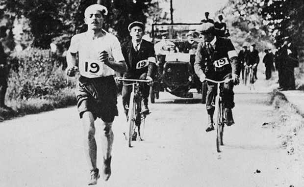 1908 Olympic Marathon, London, Dorando Pietri stretches his huge lead, only to collapse in the stadium and be disqualified. Johnny Hayes of the USA finished 2nd but was declared the winner.
