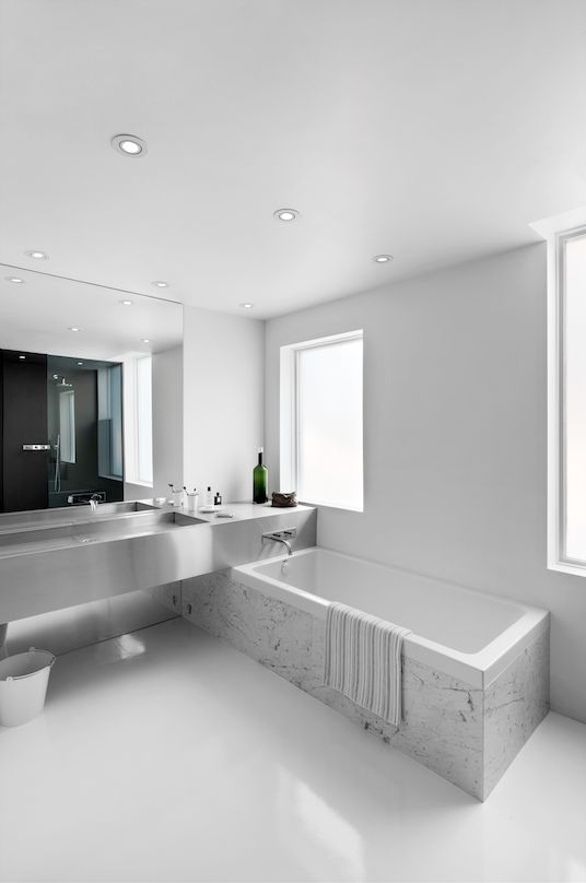 Marble bathtub and stainless steel countertop